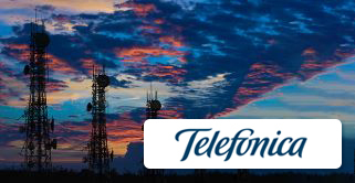 Telefonica logo with service towers and a sunset as background